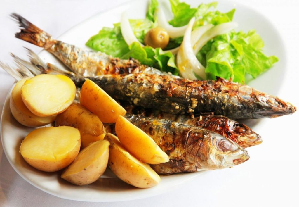 grilled sardines - traditional portuguese dish