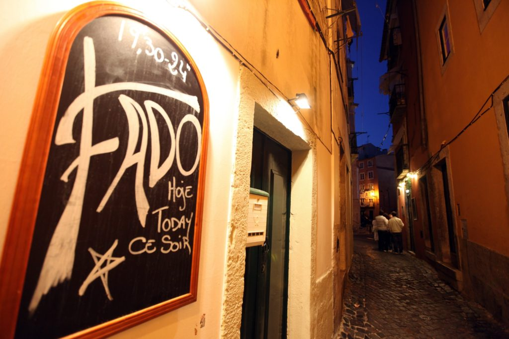 Narrow street of Lisbon with a Fado restaurant