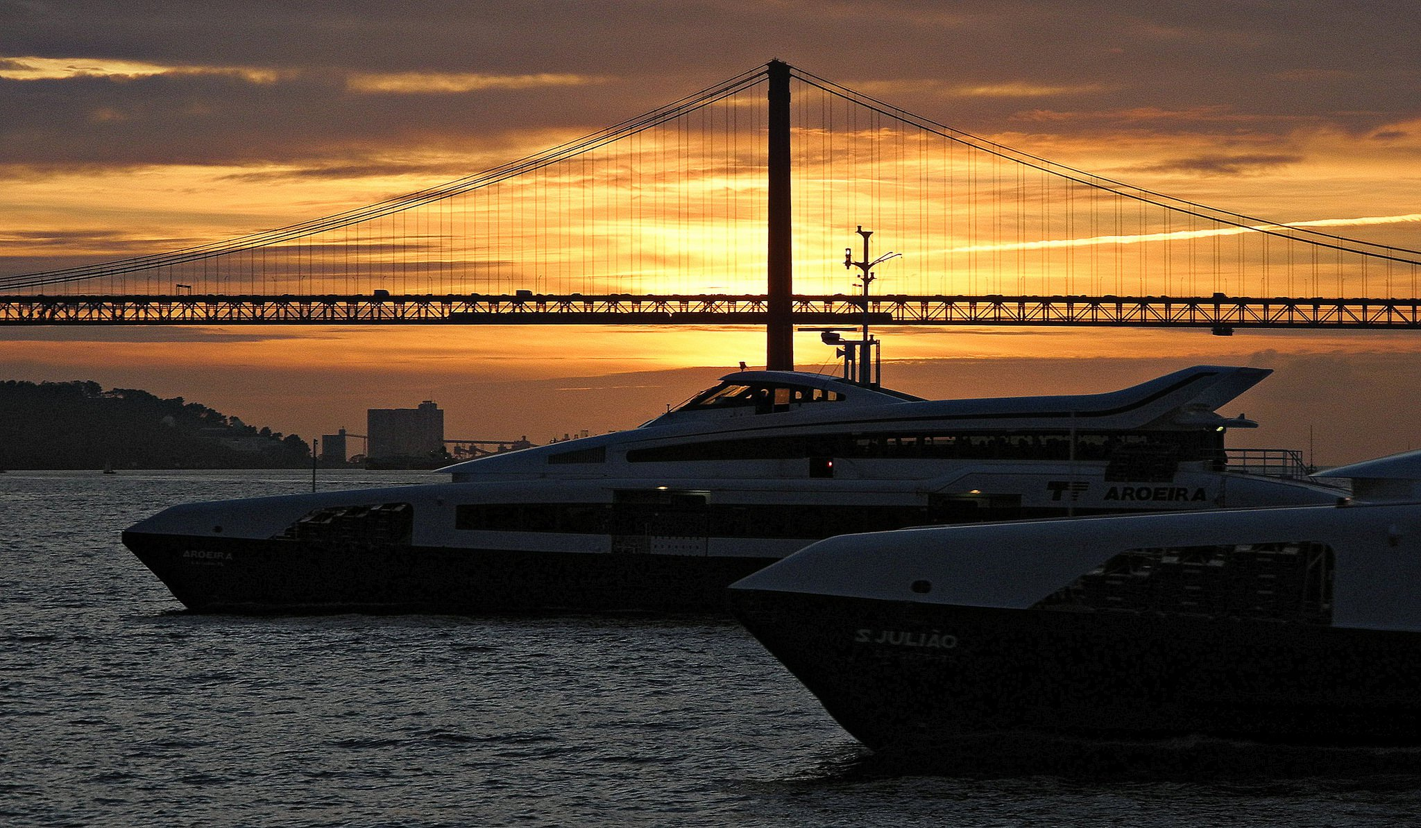 Lisbon boats and ferries at sunset